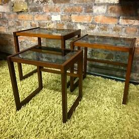 Lovely mid century teak nest of tables with smoked glass tops