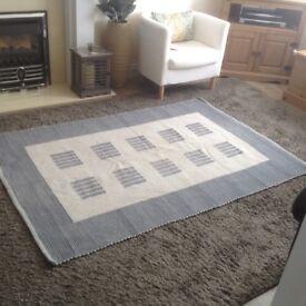Pale blue-grey /cream rug