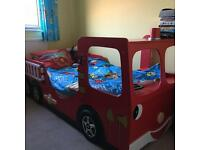Fire engine bed and desk with one chair.