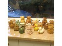 21 assorted ceramic honey pots.