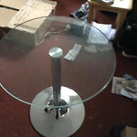 Glass circular table with steel base new in box