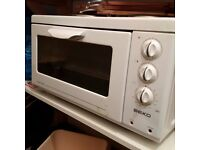 compact table top electric cooker with oven grill and two hotplates can deliver