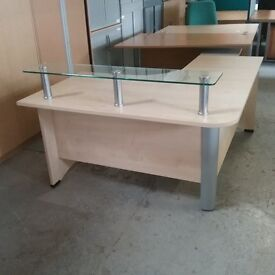 Right hand curved beech reception desk with a glass shelf