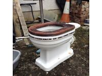 Victorian replica white toilet with decorative stripe around pan and cistern