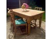Solid pine dining table with 4 William Morris chairs