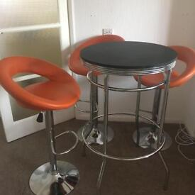 Barstools and table