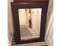 Brown leather look mirror measures 47x33