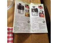 Red kitchen Magimix duo juicer and pulper. Ideal for juicing fruit and vegetabled