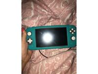 Nintendo switch lite with accessories and games available