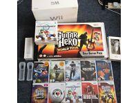 Nintendo Wii Bundle *2 Controllers/Nunchuks + Guitar Hero Controller + 10 games*
