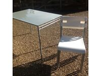Ikea glass topped table and 4 stacking chairs