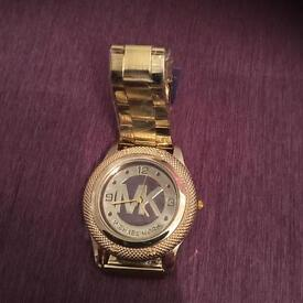mK watch in gold and brown