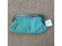 new wirh label. designer clutch bag / handbag. pale turquoise wirh darker turquoise trim.