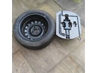 Full size spare wheel and tyre, never used, fits Rover 25, plus jack.
