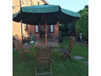 Garden table, chairs & parasol