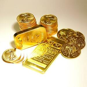 looking for some kind of neat gold coin or bar & neck chain Kingston Kingston Area image 1
