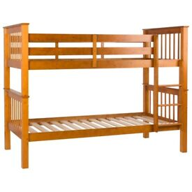 Limelight Pavo bunk beds in honey pine with 2 under bed drawers