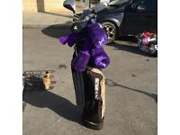 Golf clubs bag balls and tees