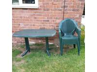 Green garden table and four chairs