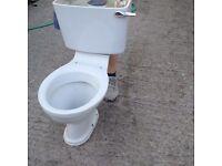 White Ceramic Toilet in Good Condition