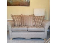 2 seater sofa with reversible cushions very good condition
