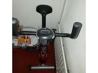 EXERCISE BIKE HARDLY USED. PURCHASED ON WHIM.