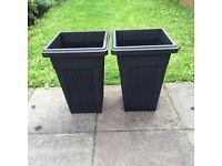 Two large black pots