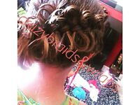 Hair braiding and wrapping, many styles!! Check out our pictures!!