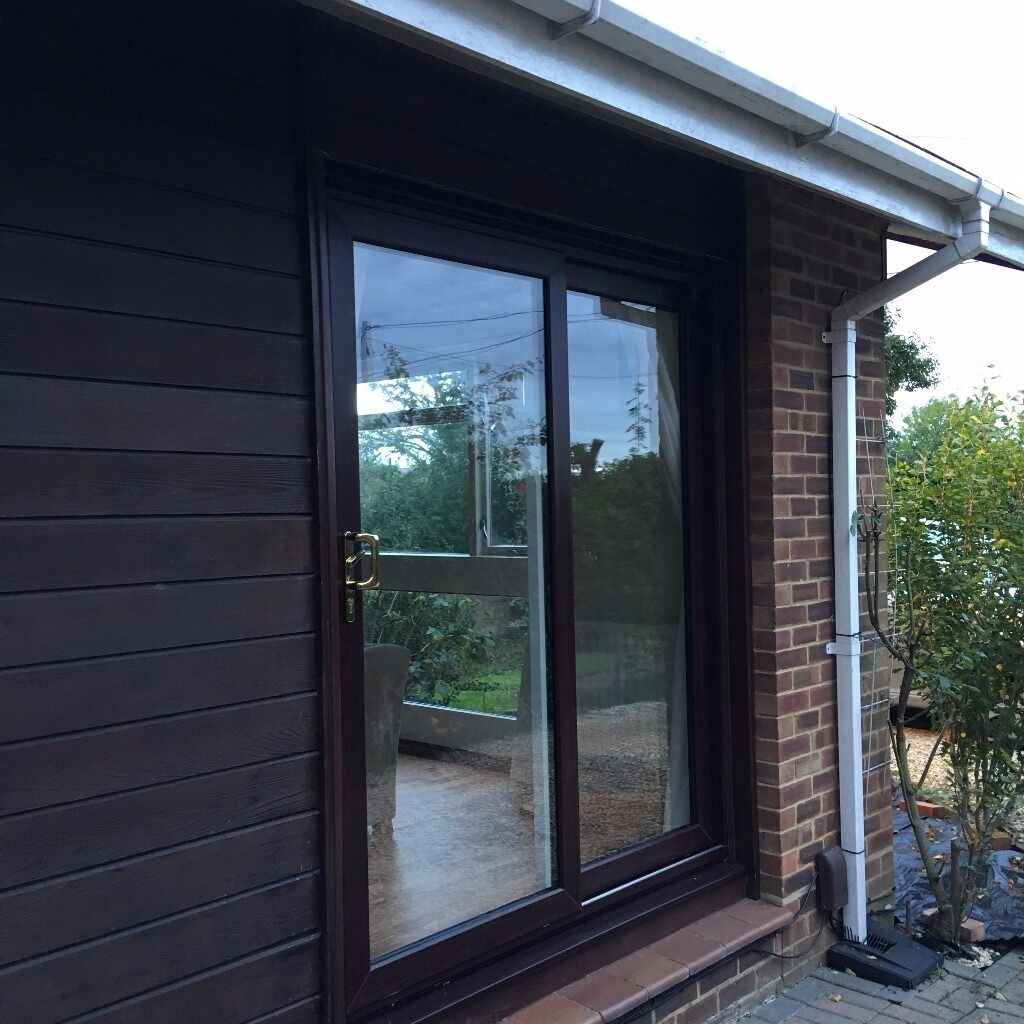 Sliding patio doors dark brown outside white inside for Brown upvc patio doors