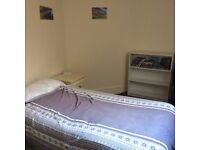 Room to rent in central, seafront apartment.