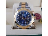 Two tone Rolex Daytona blue face, Gold Bezel. Comes Rolex bagged, Boxed with paperwork