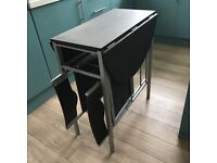 Space saving table and 2 chairs in black Excellent condition