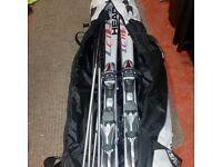 Skis,poles and double ski bag.