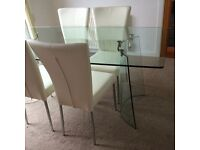 Glass Dining Table with 4 Ivory Faux Leather Chairs.