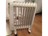 electric portable radiator heater on wheels