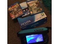 PS Vita + accessories + 2 games