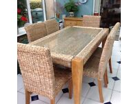 Cane dining table & 6 chairs.