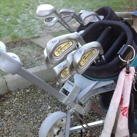 Selection of golf clubs and trolleys