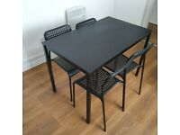 Lovely black wooden dining table with 4 chairs