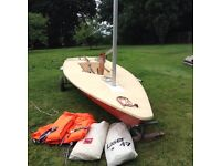Laser sailing dinghy with road trailer and launching trolley.