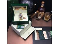 Rolex Daytona with Black Face and TwoTone Bracelet comes Bagged Boxed and with Paperwork