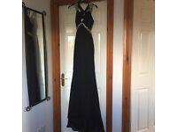 Black, jewel encrusted formal dress