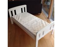 Wooden toddler bed in white