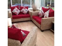 Beautiful conservatory suite 2 x 2 seater sofas and chair plus table.
