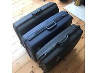 3x hard shell Samsonite & Delsey wheeled suitcases