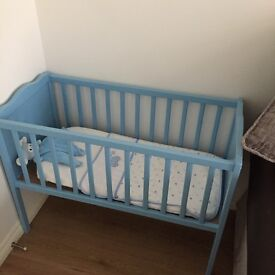 Blue crib from birth.