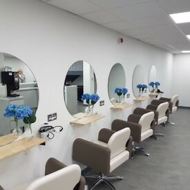 Busy large hair salon offering a beauty room