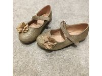 Girls gold glittery shoes