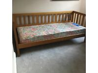 Solid wooden day bed with single mattress