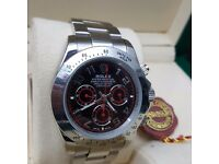 New silver Rolex Daytona with Black Face and Red Features Comes Rolex Bagged Boxed With Paperwork